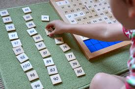 Child working on the 100 board
